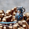 Porte-clefs lillipuce kokeshi aster 3 cm
